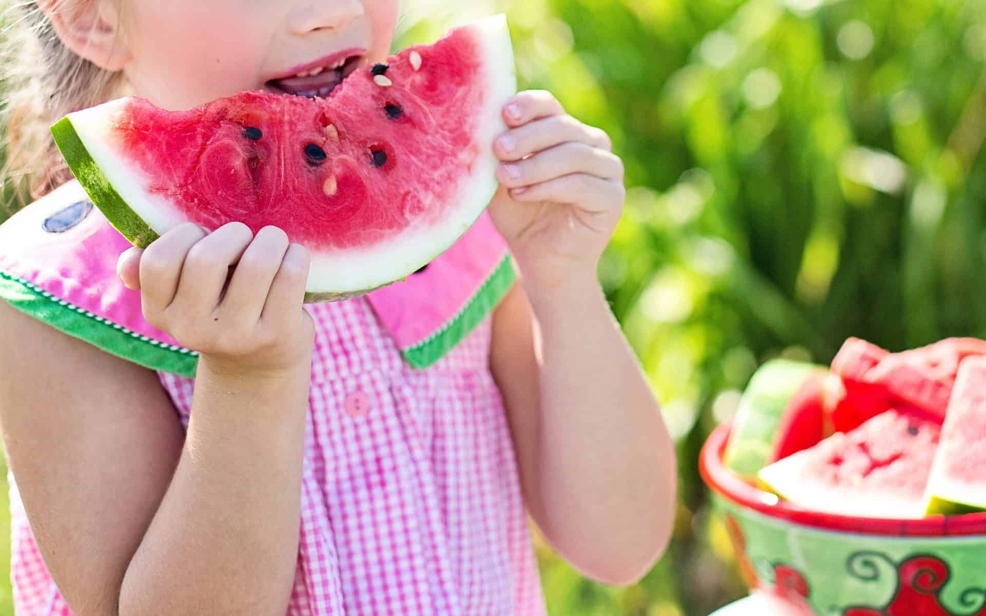 Child eats watermelon