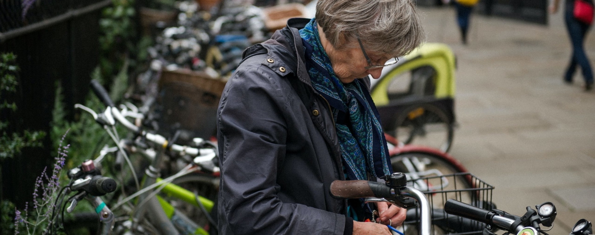 Woman with a bike. Keeping our ageing population active – the role of healthcare professionals.